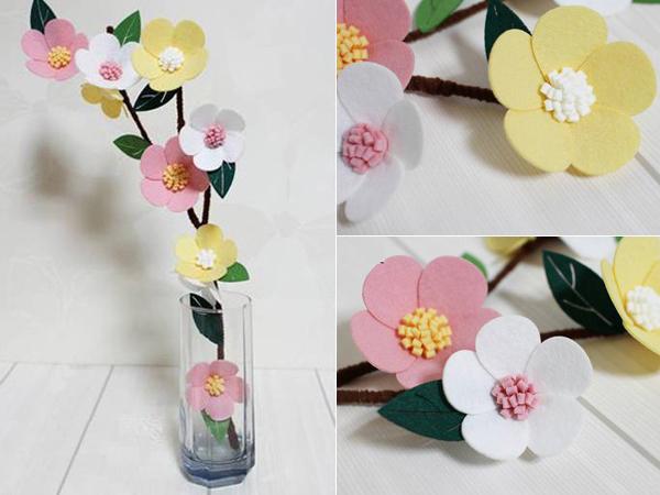 Trang trí tết cho phòng khách bằng cách làm hoa bằng vải xinh
